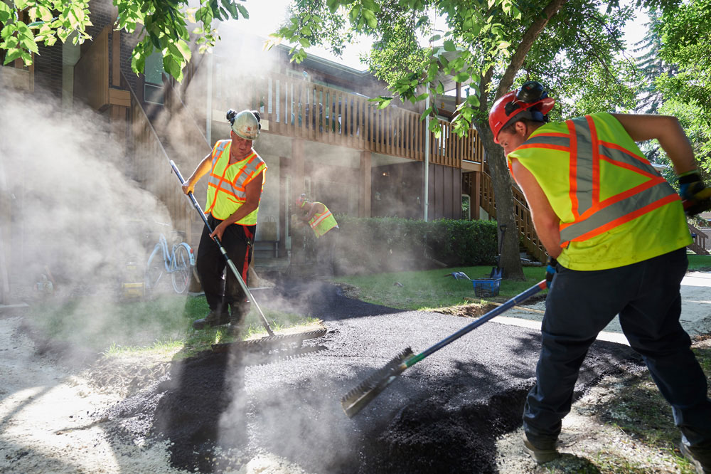 The Superior Asphalt team builds a new residential walkway in Winnipeg