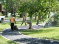 The Superior Asphalt team smoothing out a new walkway in Winnipeg